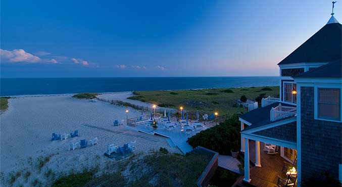 The private beach at dusk at the Beach Resort in Harwich Port showing pristine sands and loungers