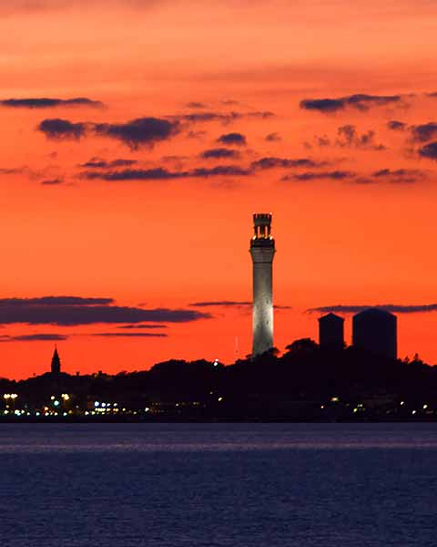 Provincetown sunset with monument in view